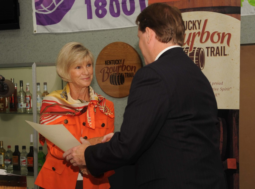 "First Lady Jane Beshear presents KDA President Eric Gregory with the official Proclamation declaring September ""Bourbon Heritage Month"" in the Commonwealth."