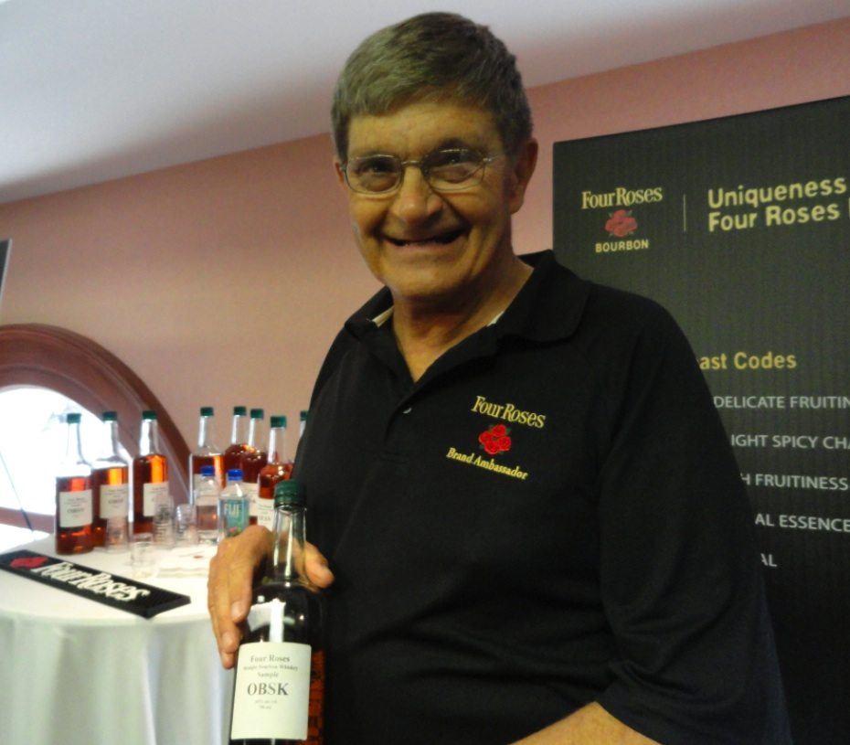 Four Roses_Brand Ambassador Al Young holds a bottle OBSK, one of the Ten Unique Recipes of Four Roses Bourbon, all ten were sampled for the first time ever at Tales of the Cocktail 2011