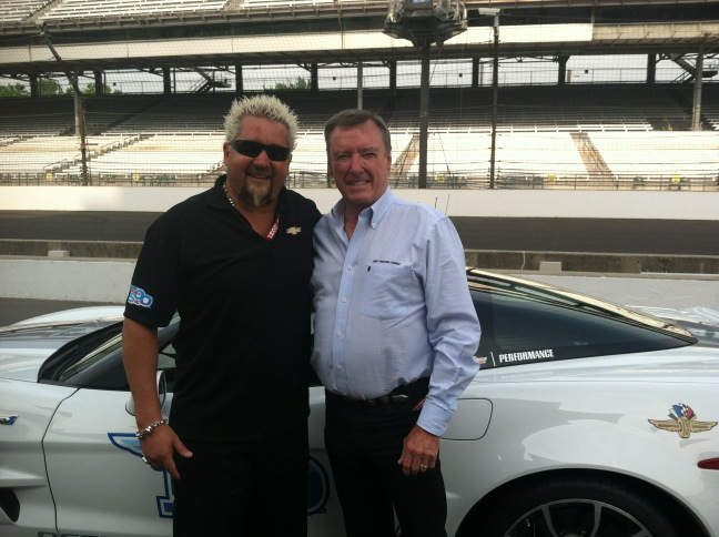 Guy Fieri as he finishes his practice run with 3 time Indy 500 champ, Johnny Rutherford