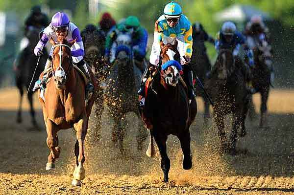 I'll Have Another and jockey Mario Gutierrez, left, edge Bodemeister and Mike E. Smith, during the 137th running of the Preakness Stakes at Pimlico Race Course on Saturday. (photo courtesy Patrick Smith / Getty Images /)