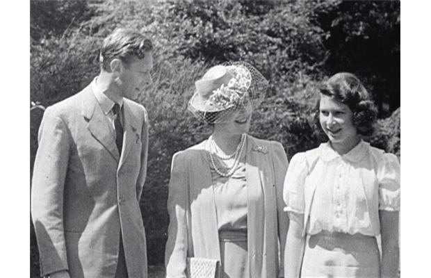 Britain's Queen Elizabeth (the then Princess Elizabeth) (R), her mother Queen Elizabeth (C) and father King George VI, from archive film footage. The film, entitled Royal Road, was shot during a car trip around the grounds of Windsor Castle in 1941.
