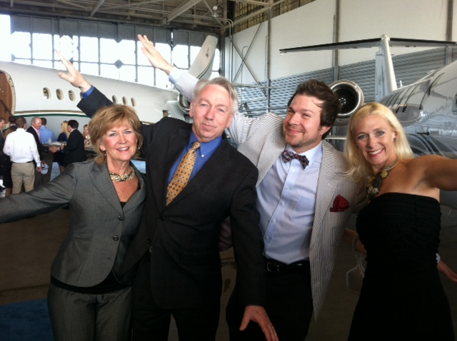 Ron Geary and his Family with BourbonBlog.com's Tom Fischer at Louisville Executive Aviation, all pretending to be jets