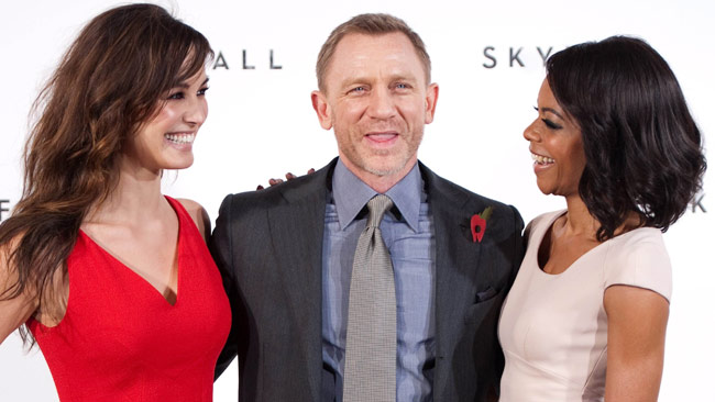 James Bond (Daniel Craig) with new  Bond Girls ( Bérénice Marlohe is at left; Naomie Harris, a.k.a. Miss Moneypenny, at right)