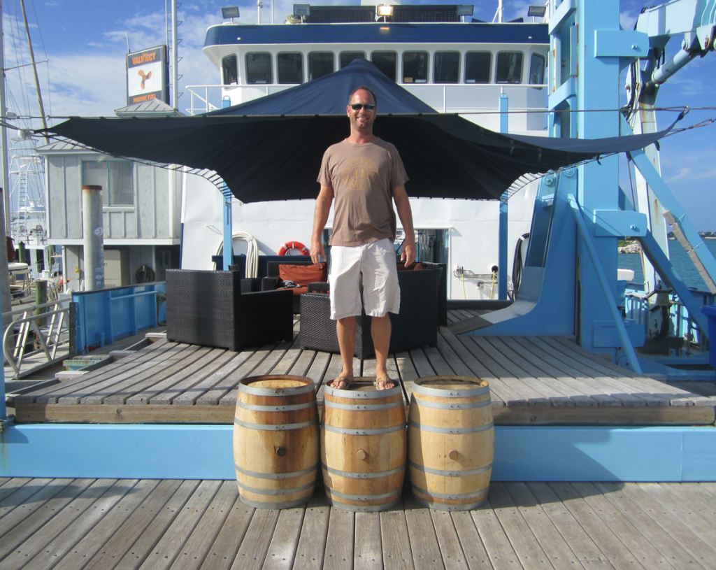 "Trey Zoeller, founder and master blender of Jefferson's Bourbon, stands atop the barrels of bourbon which have been ""ocean-aged"" for 4 years"