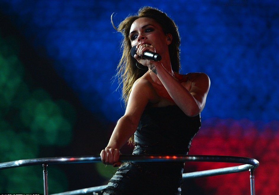 Victoria Beckham with The Spice Girls performing in the London Olympics