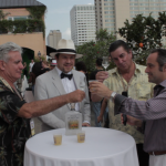King Cocktail Dale DeGroff, BourbonBlog.com's Tom Fischer and Pisco Porton's Master Distiler John Schuler and CEO Jean-Francois Bonneté at Tales of the Cocktail toasting atop Hotel Monteleone Poolside