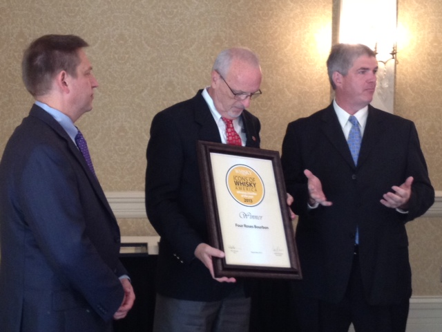 Four Roses Master Distiller accepts the Icons of Whisky Award from Mark Gillespie and Dave Sweet of Whisky Magazine