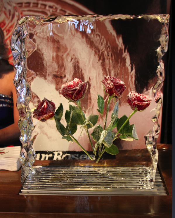 4 frozen roses in a block of ice that appear the same as they did in a vintage Four Roses advertisement that won many awards