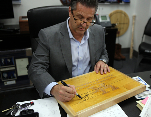 John Calipari Autographs the Floor from New Orleans where UK won the title of 2012 NCAA Champions