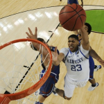 UK forward Anthony Davis (23) goes to the hoop against Kansas center Jeff Withey (left) during the second half of the national championship game 2012