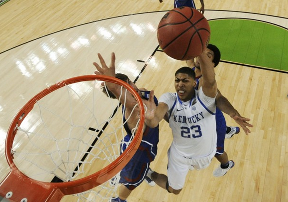Kentucky forward Anthony Davis (23) goes to the hoop against Kansas center Jeff Withey (left) during the second half of the national championship game.