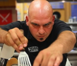 Chef Michael Symon cooking