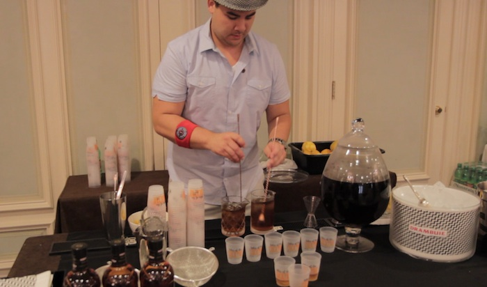 Nathan Grenne mixing his winning cocktail Nuttin Honey